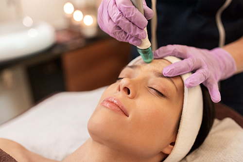 woman-having-microdermabrasion-facial-treatment-pzepl2kresize.png